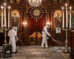Workers of Istanbul's Metropolitan Municipality disinfect the Panagia Altimermer Orthodox Greek Church in Istanbul to prevent the spread of the COVID-19, caused by the novel coronavirus on March 15, 2020. - Turkey halted flights with nine European countries the transport minister said on March 13, after having already shut all schools for two weeks and bar spectators from football matches through April, as part of Ankara's bid to contain the spread of the new coronavirus. (Photo by Ozan KOSE / AFP) (Photo by OZAN KOSE/AFP via Getty Images)